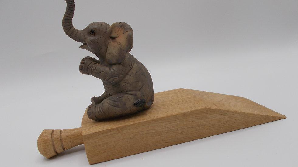 Oak door stop with Elephant