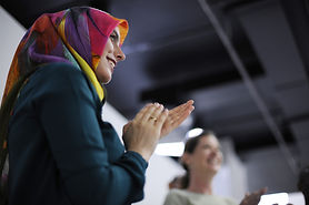 Woman in headscarf clapping.jpg