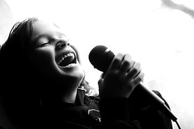 Kid%20singing%20song%20with%20microphone
