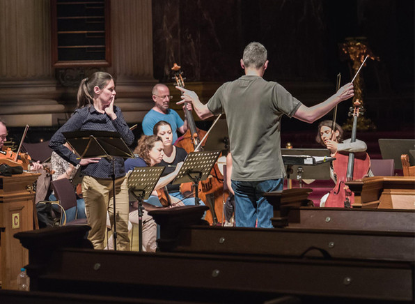 Dario Salvi conducts a rehearsal of Meyerbeer's Sacred Music in the Berliner Dom with soprano Andrea Chudak and the Neue Preußische Philharmonie.  Photo credit: Alex Adler