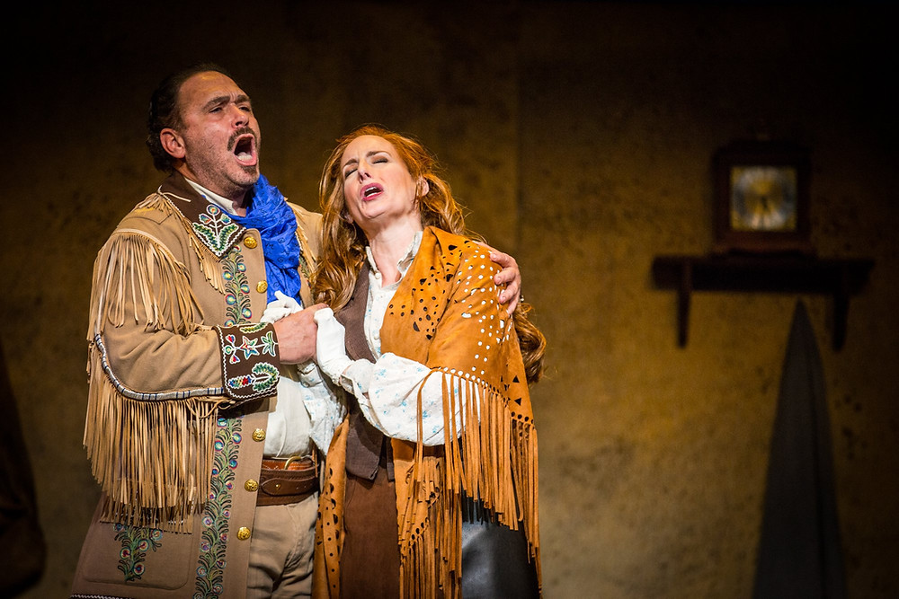Jorge Pita Carreras (Ramerrez) and Karen Kanakis (Minnie) singing in each other's arms in La Fanciulla del West