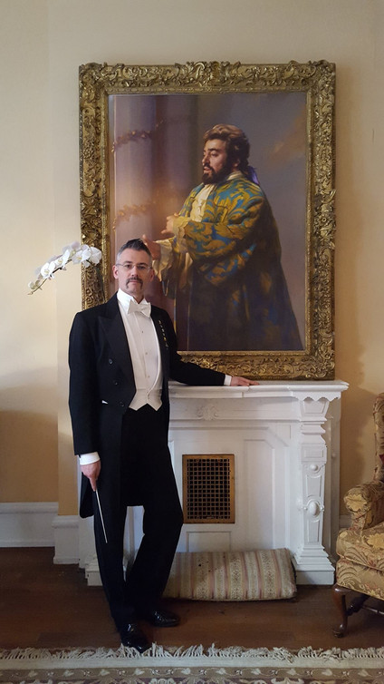 Dario Salvi with a portrait of Pavarotti in the Academy of Vocal Arts in Philadelphia