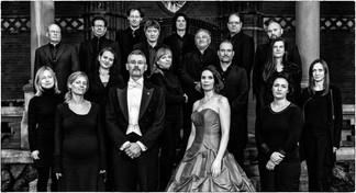 Dario Salvi with Andrea Chudak and the Neue Preussische Philharmonie.  Photo credit: Alex Adler