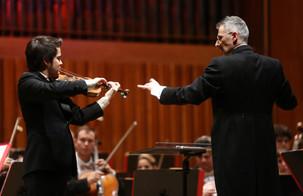 """Dario Salvi conducts Saint-Saëns """"Introduzione e Rondo Capriccioso"""" with Luka Ljubas on violin.  Photo credit: Marko Pletikosa"""