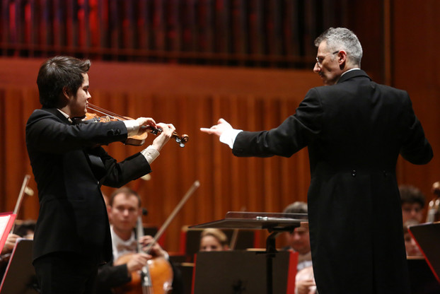 "Dario Salvi conducts Saint-Saëns ""Introduzione e Rondo Capriccioso"" with Luka Ljubas on violin.  Photo credit: Marko Pletikosa"
