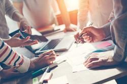 Teamworkprocess.Marketingstrategybrainstorming.Paperworkanddigitalinopenspace.Intentionalsunglare-30