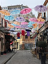 A variey of vibrant, colorful umbrellas floatng in the air