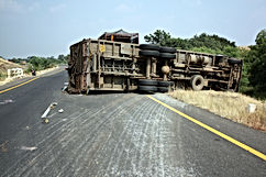 A view of an overturned truck on an high