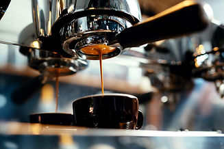 Close-up of espresso pouring from coffee