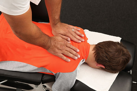 chiropractor adjusting a boy