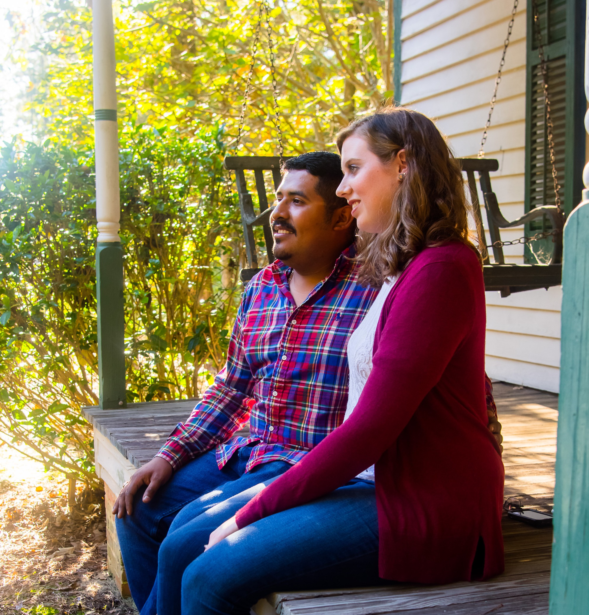 Two people sitting on historic porch