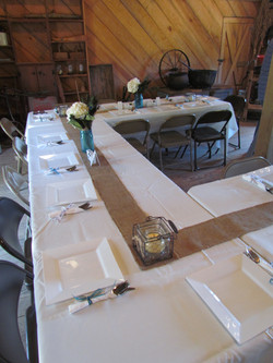 Tables set up with burlap runner