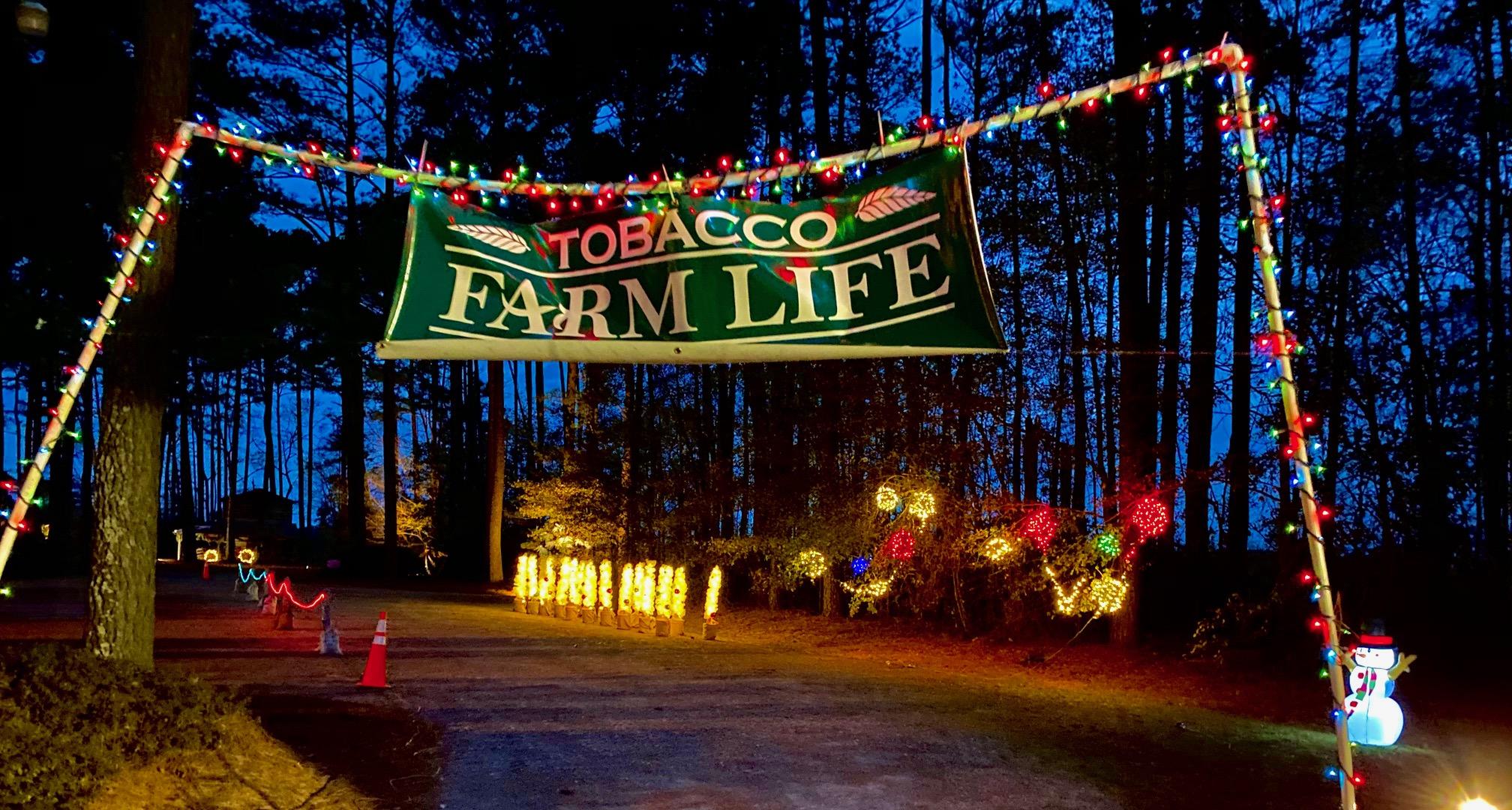 Tobacco Farm Life banner with Christmas lights