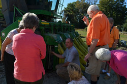 People gathered around tractor
