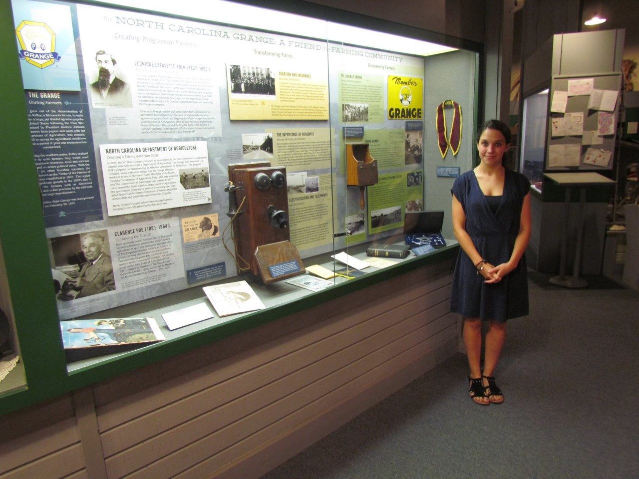 Intern standing next to exhibit