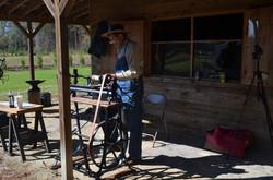 Blacksmith demonstrating tools