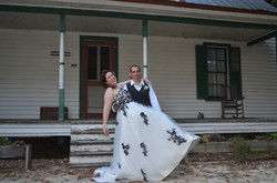 Bride and groom by historic house