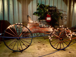 A historic wagon with Christmas lights
