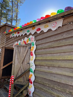The packhouse with gingerbread house decorations that look like candy.