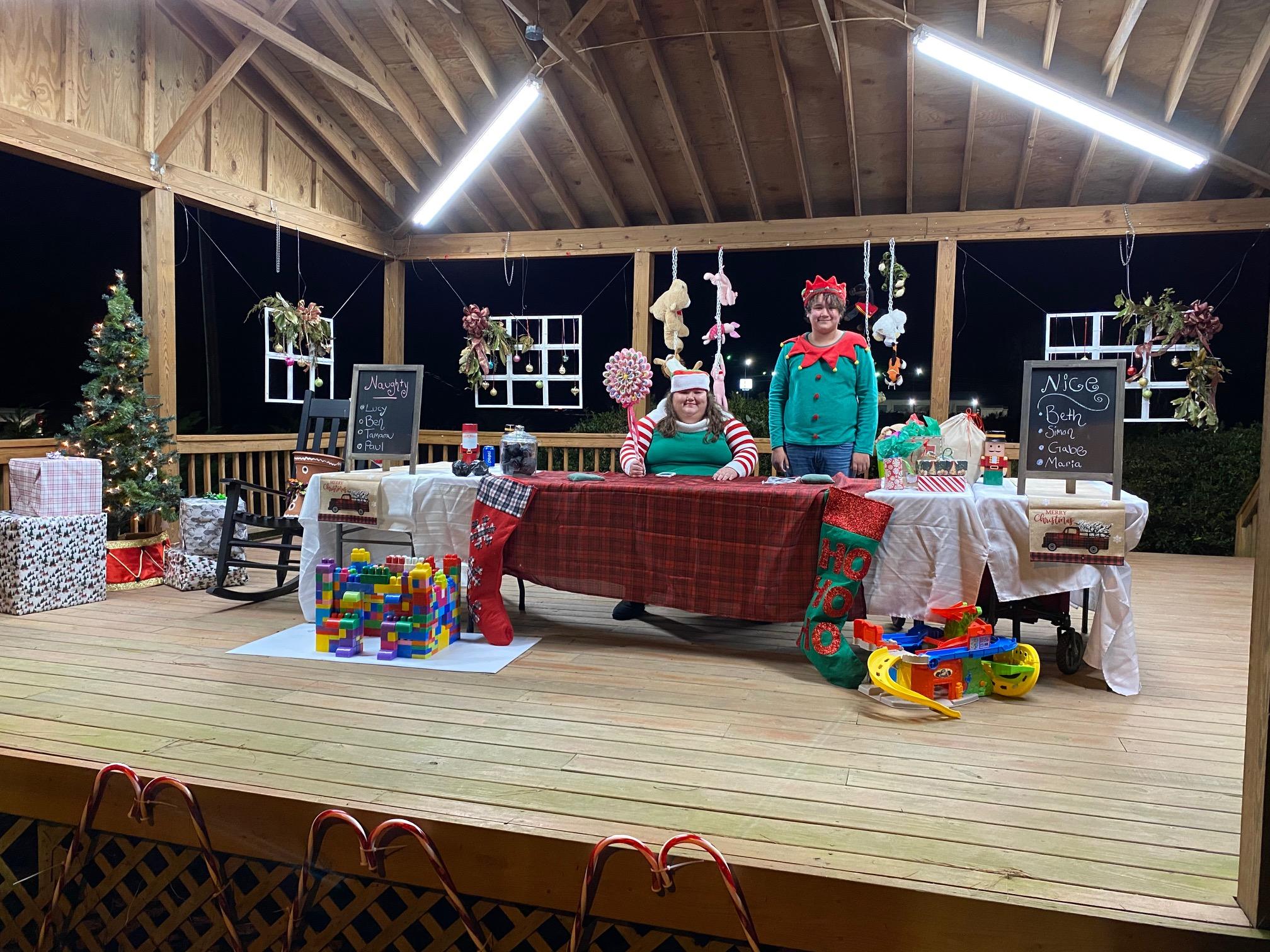 Volunteers in Santa's Workshop dressed as elves.