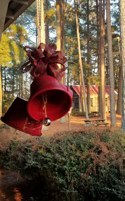 Red bells made from plant pots.