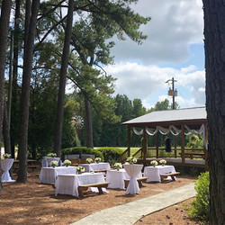Tables with white tablecloths