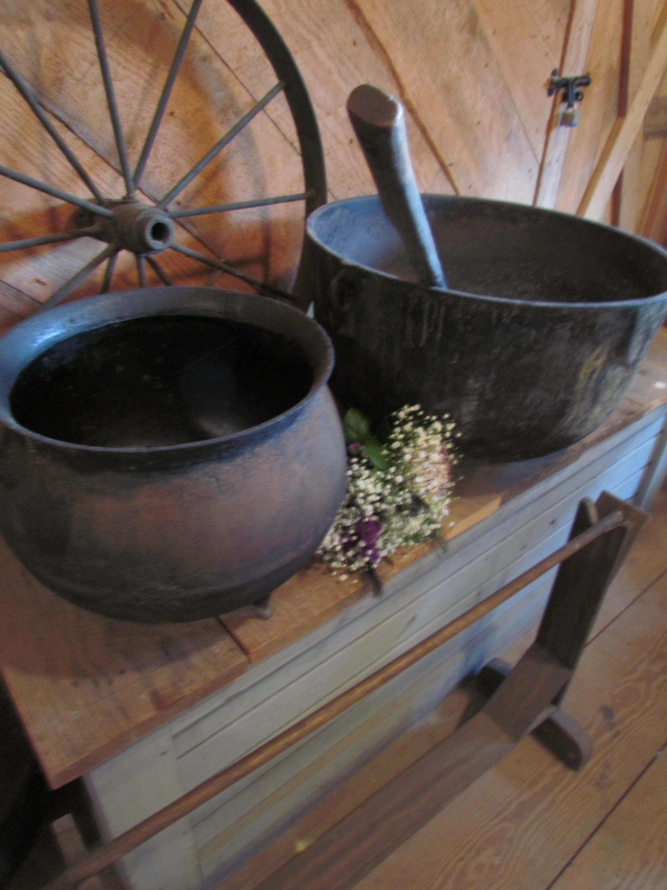 Iron pot, wheel, flowers, rustic