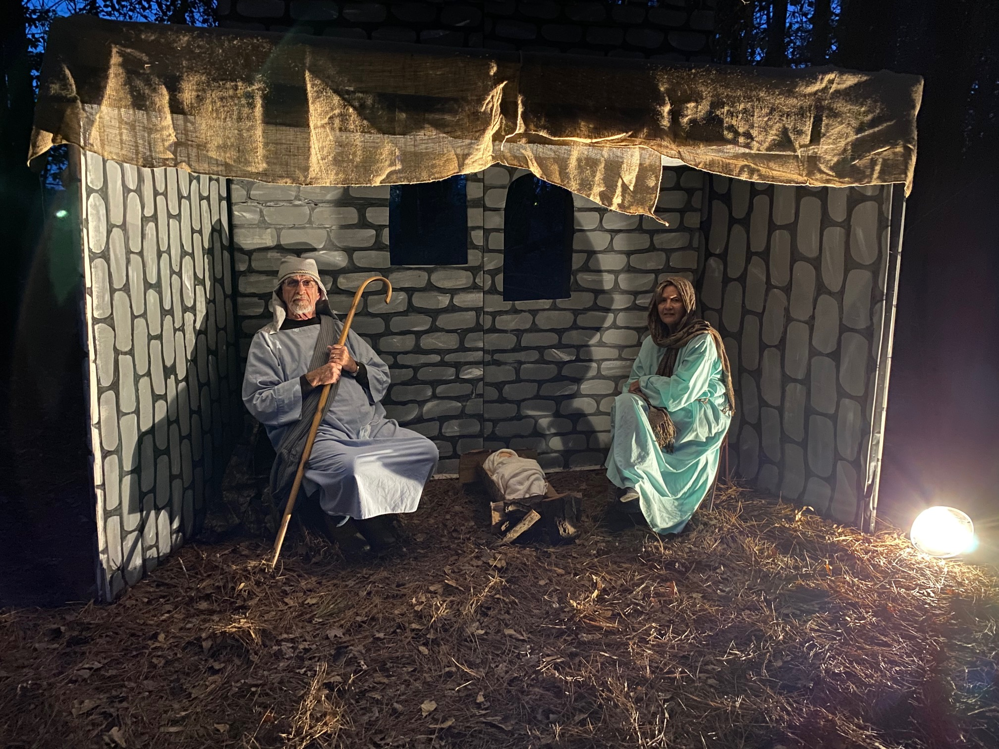 A living nativity scene with Mary and Joseph.