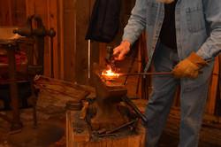 Blacksmith hammering hot metal