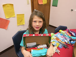 Child with shoebox.jpg