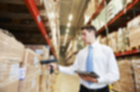manager worker in warehouse with bar cod