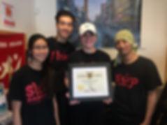Four Slurp teammates holding an award