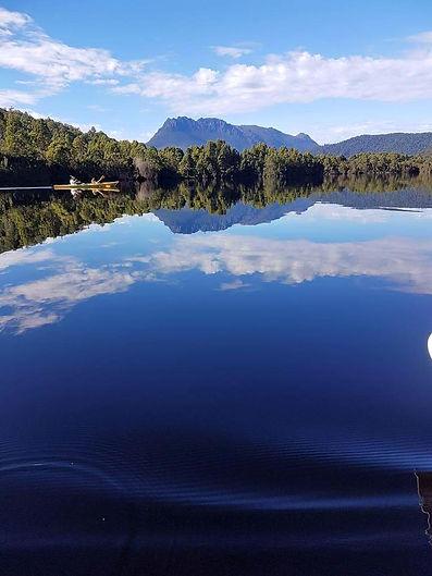 Kayaking on Lake Rosebery, Tamania from Tullah Lake Side Lodge