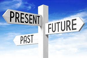 Future, present, past - wooden signpost.