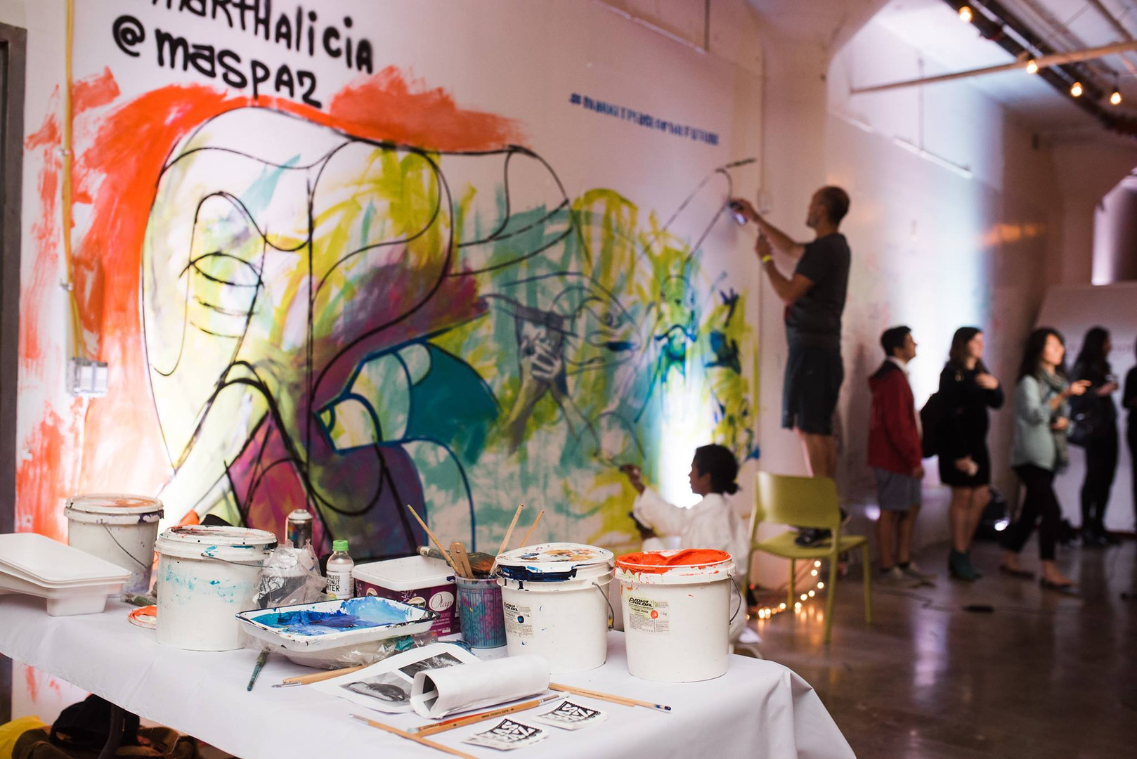 Marthalicia Matarrita Painting at the Marketplace of the Future