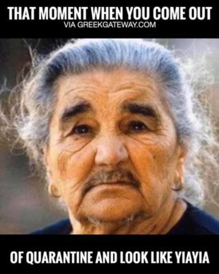 Image of old woman with grey hair and moustache.