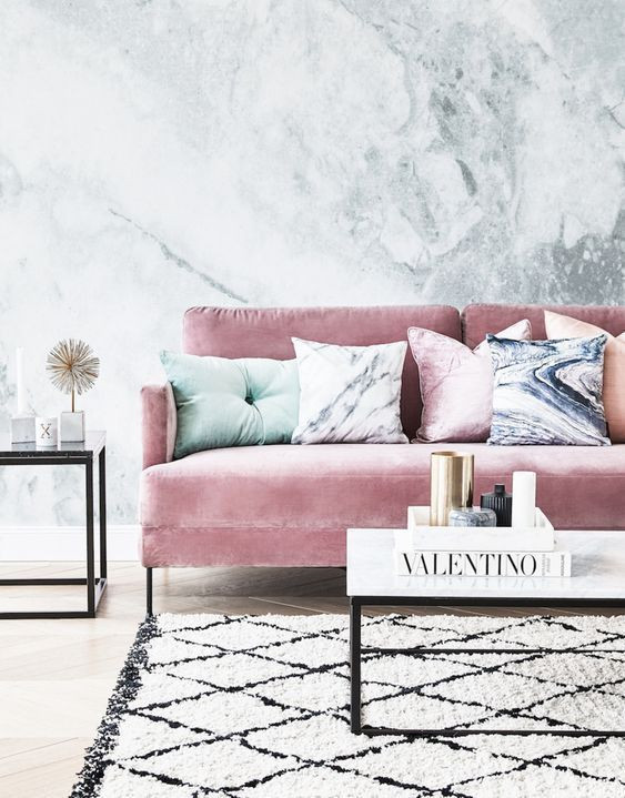 Luxe-styled living area with pink velvet sofa