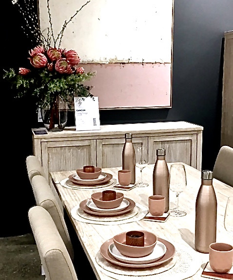 Dining table dressed with pink crockery