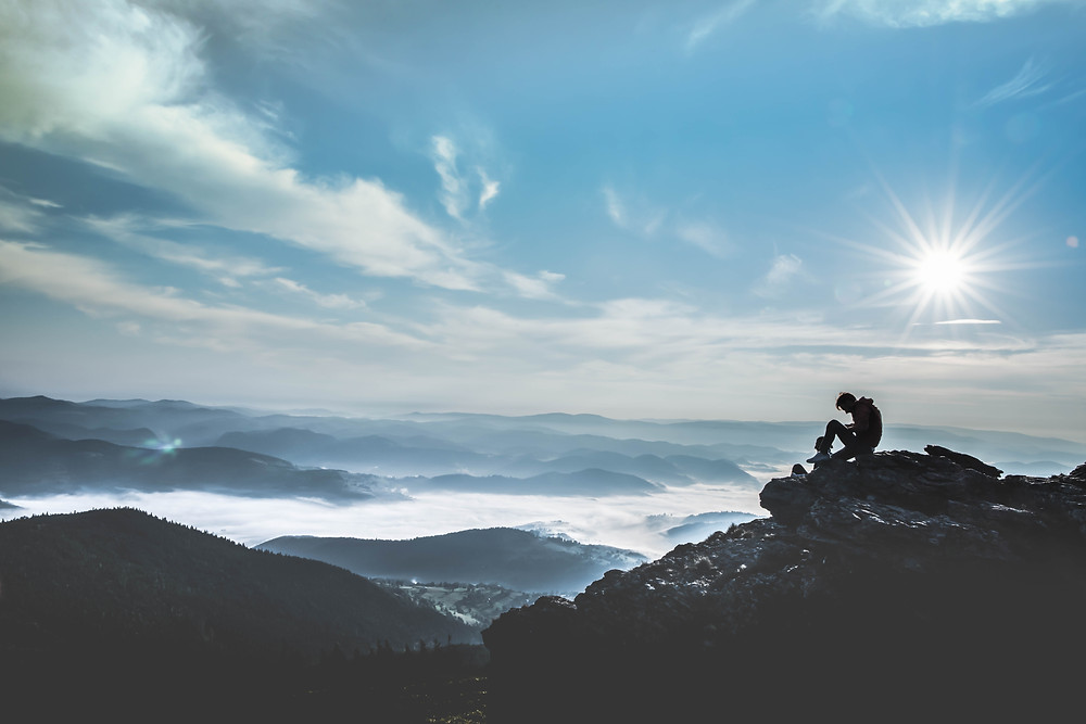 Man looking out onto world.