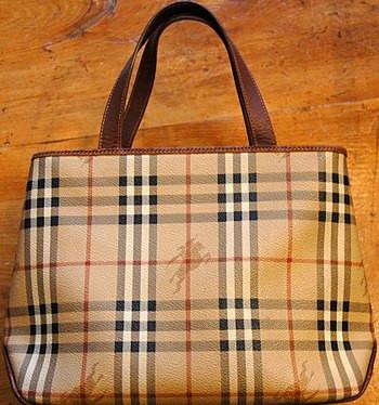 A ladies' Burberry handbag in the company's tr...