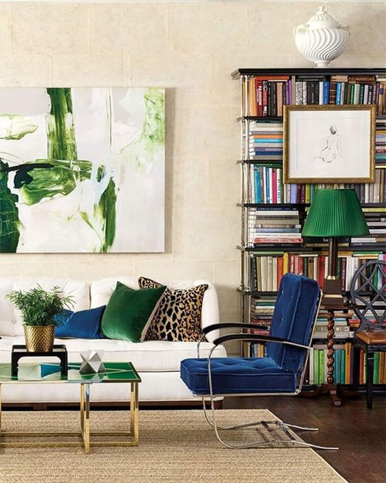 Eclectic living room with jewel tone accessories and chair