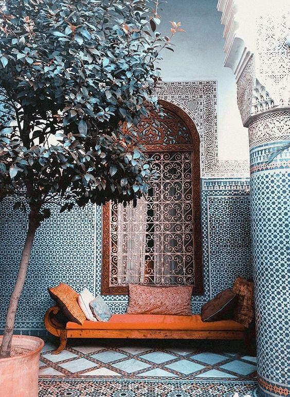 Moroccan scheme with blue tiles and coral velvet chaise