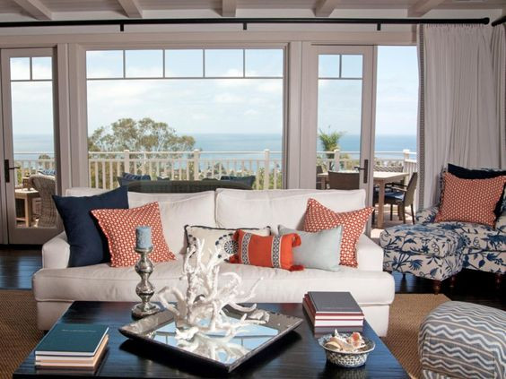Coastal living room with blue and coral cushions