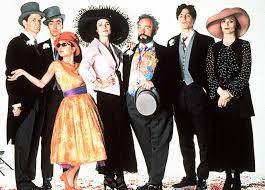 Movie poster of Four Weddings and A Funeral showing the main cast