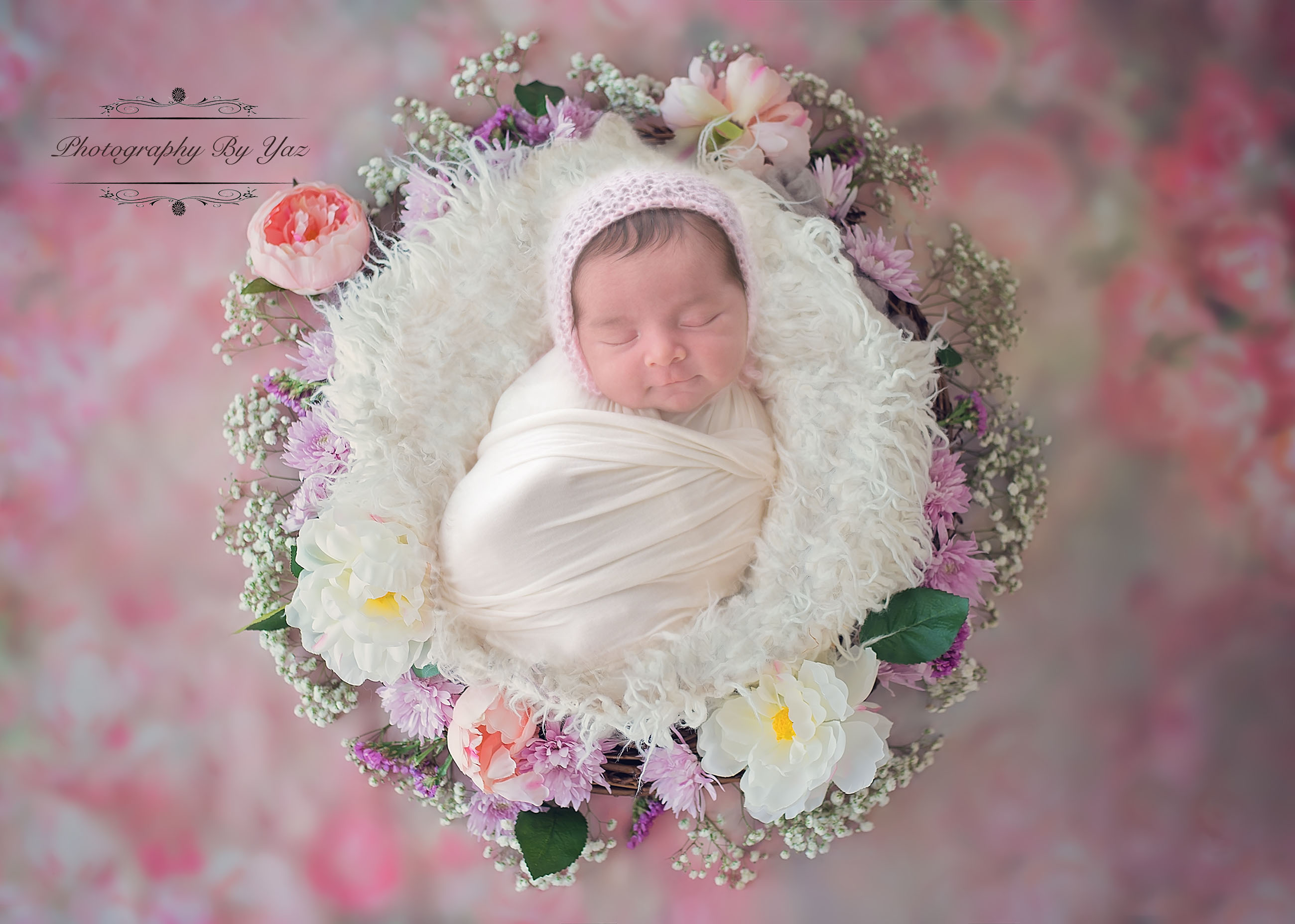 baby with flowers and flower basket