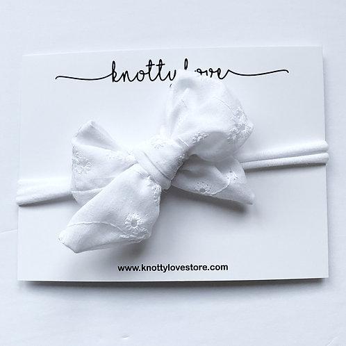 White Eyelet Pinwheel Bow