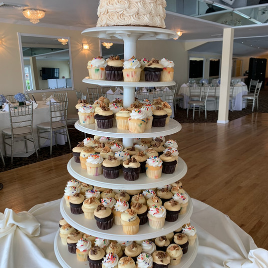 A cupcake tower provides with an assortm