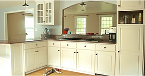 Beautifully spray painted cabinets to appear as new. Cabinet Refinishing.