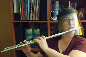 Emily with face shield and flute.jpg