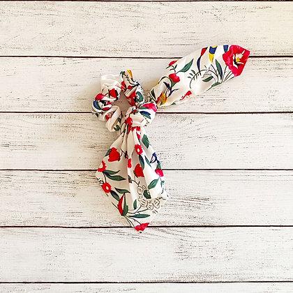 Colet cinta flores blanco